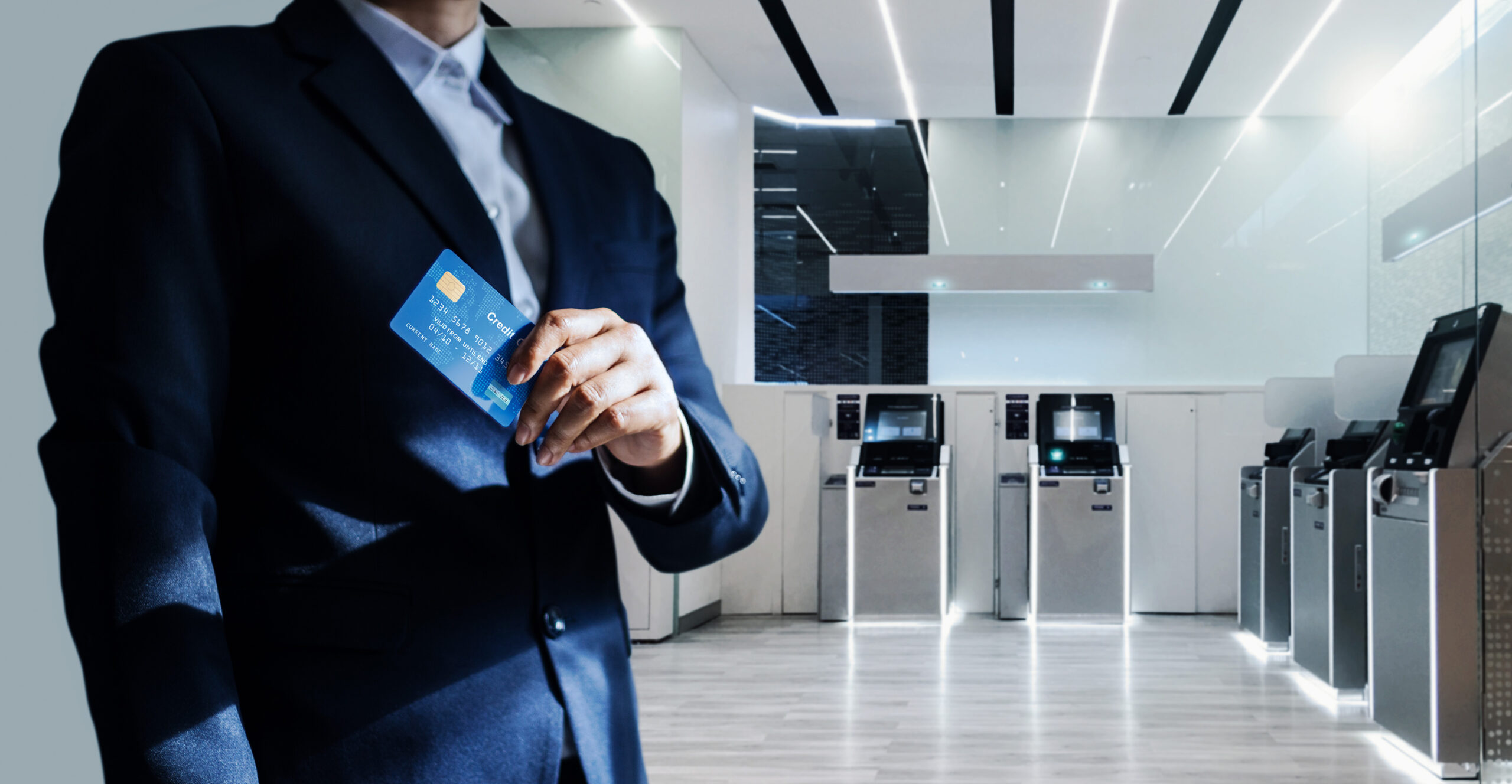 Bank manager and credit card in hand, business man standing confidently with pride in financial modern, futuristic, technology and banking network connection